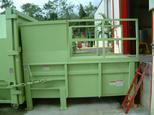 Stationary Compactor with Hand Rails & Floor Plate over unit.